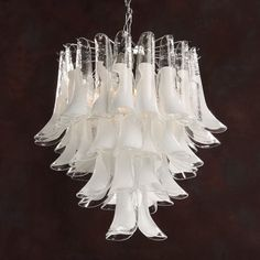 Handmade in Murano, the Autumn Leaves Chandelier is made by a master glass blower and his team. This impressive chandelier comes in two size options and one colour. Each leaf has a simple, curved shape made from clear and white glass.