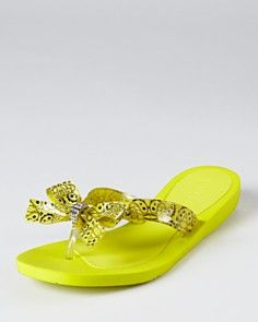 Yellow flip-flops, different