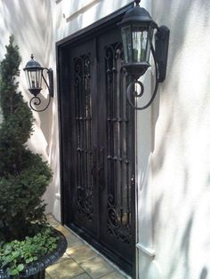 Iron Door - A Signature Entry  French Courtyard . Topiaries Lights and an & Millhouse Collections: Category: A French Courtyard by Sue Daley ... pezcame.com