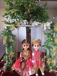 bride and groom swinging in a garden Barbie Decorations, Handmade Decorations, Diwali Pictures, Thali Decoration Ideas, Janmashtami Decoration, Wedding Doll, Indian Dolls, Wedding Gift Wrapping, Engagement Decorations