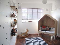 Triangular vinyls & black and white cloud & leather baby mobile from Jessica Barnard, lamp from Graeme Bettles Design, Bokkie Rocker from ilovebokkie, hand drawn little houses by Jean de Wet, rug from Mr Price Home and fox pillow from Country Road.