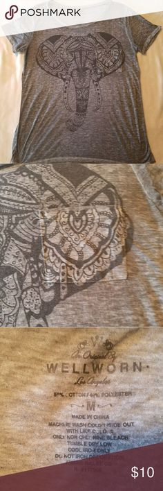 Well Worn Burn Out Style Gray Elephant t-shirt Well Worn Ladies thin Burn Out Style Gray Elephant T-shirt Tshirt sz M. Short sleeve graphic elephant tee. Front pocket.  Excellent pre owned condition. Smoke free home. Size Medium. Cotton poly blend Well Worn Tops Tees - Short Sleeve