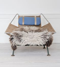 Hans Wegner, Denmark //   The original `Flagline` lounge chair with sheepskin throw. // H80 x W105 x D120cm
