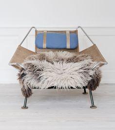 Hans Wegner, Denmark //  The original `Flagline` lounge chair with sheepskin throw. // H80 x W105 x D120cm