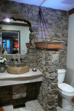 You don't have to redo your entire bathroom in order to make it your own. Try adding special touches that show off your favorite things, like RMR user Ken Gregory did here by adding his old golf clubs above the stone wall.