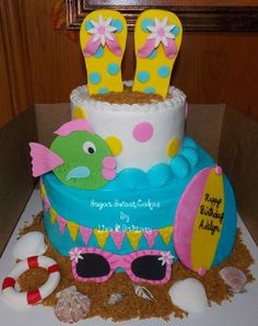 """Beach Themed ~ 1st Birthday - 6"""" & 10"""" buttercream cake with fondant decorations & matching 6"""" smash cake. All decorations (ball, life raft, fish, flip flops, 1, & sun glasses) were hand made out of gum paste. The sea shells are real, didn't have enough time to make edible ones. TFL!"""