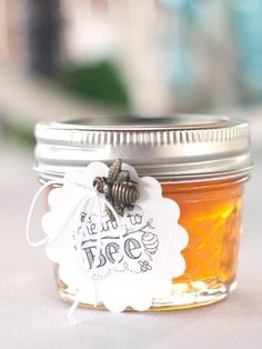 "Attach playful ""Meant to Bee"" labels on jars of honey to send your guests away with a sweet favor."