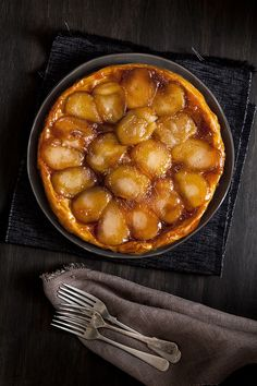 Tarte tatin is an upside-down tart made up of sticky caramel, soft apples and slightly chewy golden pastry.