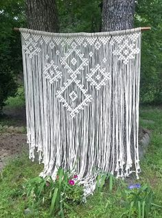 Large macrame on solid birch pole. Macrame is about 5 ft wide and about 6 ft long. I used 1/8th inch off white cotton rope. each macrame is unique and may differ slightly from the photo