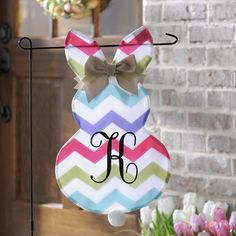 Welcome your guests right as they arrive with a colorful Chevron Bunny Monogram Flag! It will spruce up your front yard for the spring and extend your Easter celebrations outside.