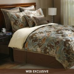 queen size bedding with browns/blues, pretty with cream colored tufted headboard