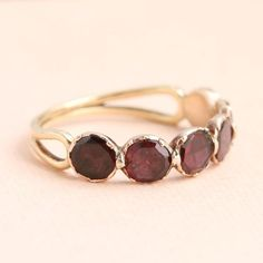 crafted in rose gold Delightful garnet paste ring with floral shoulder detailing