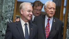 Rep. Tom Price, R-Ga., center, nominee for Health and Human Services secretary, is seen with Chairman Orrin Hatch, R-Utah, before his Senate Finance Committee confirmation hearing on Jan. 24. Tom W…