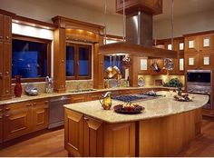 Lot's of natural light, lot's of counter space and a big enough island to accommodate the cook top.