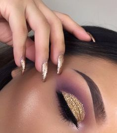 Gold and purple eye makeup.