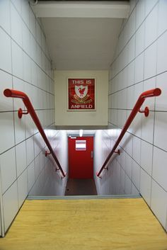 "A few photographs from our recent tour of Liverpool FC's stadium at Anfield. The player's tunnel with the pitch at the far end, and the famous ""This is Anfield"" sign. The sign was placed in this position by the legendary Bill Shankly."