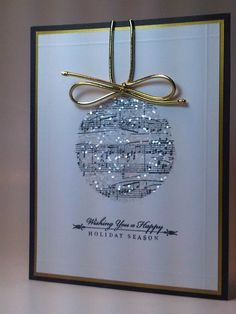 I love this glittery ornament card with the music as a background. I'm going to have to remember this for Christmas cards this year.