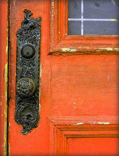 Distressed orange with old door knob.