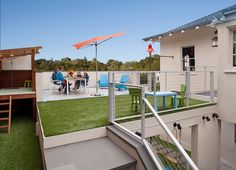 Outdoor living space on top of a carport. Is the grass real or fake?  And does it matter?  Contemporary Deck by Jeff King & Company