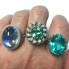 Which one is your favorite--the moonstone from @leonmege, the green tourmaline from @gumuchian or the Paraiba tourmaline from @omigems? #platinum #gemstones #jewelrylovers