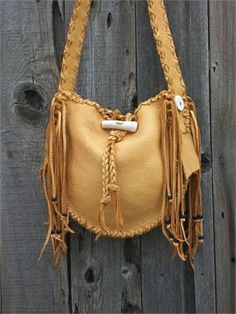 This handmade leather handbag is a wonderful bag for anyone who loves the convenience of easy access to your cell phone, wallet and all of your everyday items. The 48 crossbody shoulder strap sits comfortably on the shoulder and can be made in whatever length you like, just leave a note at checkout or send us a contact. This bag features an extra pocket on the inside, an antler closure and is decorated with lapis blue glass crow beads. The measurements are 10 tall x 10 wide x 2 3/4 deep...