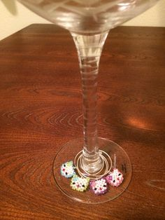 Hello Kitty wine glass charms.  Each charm the size of a dime. https://www.etsy.com/listing/192727612/hello-kitty-wine-glass-charms