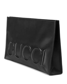 "Gucci leather clutch. Embossed Gucci logo. On mould construction. Hand-painted edges. Four covered magnets closure. Light pink suede bonded lining. 8""H x 14""W x 2.5""D. Made in Italy."