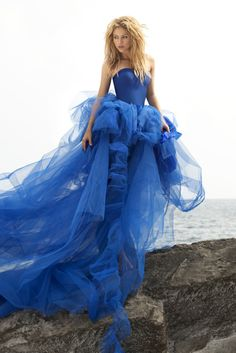 Glam blue gown with flowing tulle.