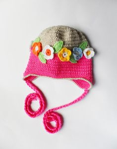 Crocheted children hat with a wreath of flowers