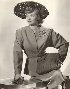 A vintage press shot of TV legend Lucille Ball wearing a Joseff of Hollywood brooch, circa early 1940s!