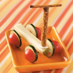 Scooter Snacks Recipe  Ingredients  •8 slices zucchini (1/4 inch thick)  •6 pretzel sticks, divided  •2 pieces string cheese (1 ounce each)  •2 pretzel rods, cut into 3-inch pieces  •2 tablespoons spreadable garden vegetable cream cheese  •4 cherry tomatoes, halved  •2 pimiento-stuffed olives, halved
