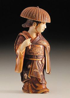 Netsuke  ~  Chikuunsai (Japan)   Wisteria Maiden, late 19th-early 20th century  Ivory with deep staining