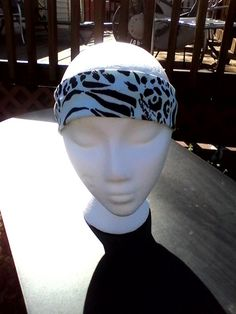 Headband is approximately 20 inches and approximately 4 inches wide  Made from stretch knit fabric  Will stretch to fit any size   Perfect for a workout or a day to day headband  Handmade in a smoke free home  Hand wash and Hang dry