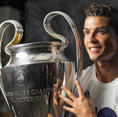 Cristiano Ronaldo holding UEFA Champions League Trophy