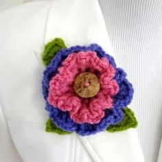 Crochet this pretty ruffle flower and use it to make a fabulous brooch or sew it to a garment or a purse.