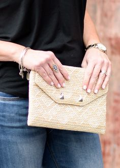 Accessorize for Spring with a statement ring and straw clutch: Metallis raffia clutch, necklace and ring are from Stella & Dot.