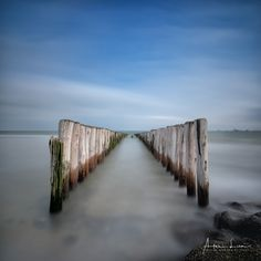 Breakwater Symmetry I - At the beach again, for some long exposure shots. Those were taken at Breskens, The Netherlands. I was close to the lighthouse of Breskens. #Breskens #beach #breakwater #coast #coastline #groyne #landscape #landscapephotography #long #exposure #longexposure #longexposurephotography #nature #naturephotography #netherlands #ocean #poles #scenic #sea #seascape #seascapephotography #sky #smooth #symmetry #water #waves