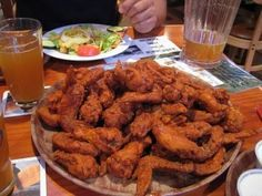 When it comes to chicken wings, the wings from Hooters are some of the best, period. It's crunchy with the gently spiced coating, and it's tossed in buttery buffalo sauce. You can choose the level of heat you want in your wings, though, so you can go mild if you're not crazy about spicy food. Of course, it's not always possible to drive to the Hooters nearest you. Thankfully, it's always possible to make your own Hooters-style wings at home.