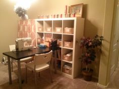 My almost finished craft room :)  I used a spring-loaded curtain road and found a cute curtain panel at Target to hide some of the boxes of vintage goods I need to sell on eBay :) (don't mind the tissue poms left over from xmas)
