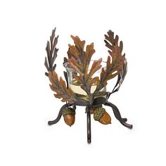 "Bronze-colored oak leaves and acorns swirl around in autumn glory. Metal holder with glass votive cup for use with votives and tealights, sold separately. 3 1/2""h.  Price:  $20.00 each"