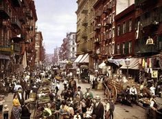 A seldom-found color image of the world of 1900 on Mulberry Street, Lower East Side NYC.