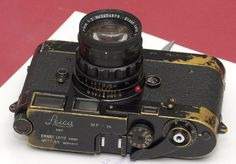 Leif Engberg's Leica MP-36 was sold on eBay for $104,000. Only 138 black versions of this Leica MP were produced, with 311 chrome versions. They were made between 1956 - 57, specifically for photojournalists.