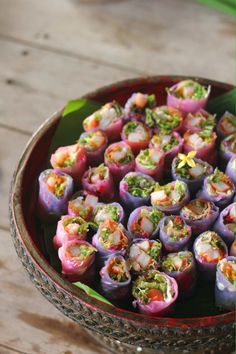 Sumer roll or fresh spring roll , prepared with crab and ponzu dressing , flower and loves .