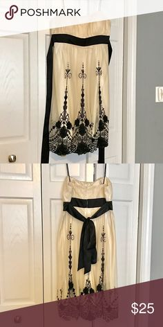 Elegant dress This is a beauty! Worn only once, this cream and beautifully designed dress is stunning. Fits comfortably and falls below knee. Built in bra top allows for no need of undergarment if you don't need much support up top. Dress Barn Dresses