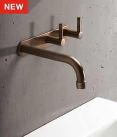 New from fixtures manufacturer Brodware, an family-owned company making hardware in Australia since the Yokato Collection of solid brass bath and kitchen fixtures. Above: The Wall Set bathroom