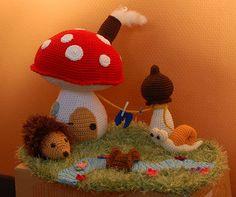 Amigurumi crochet house mushroom cottage with hedgehog, snail. $52.20, via Etsy.