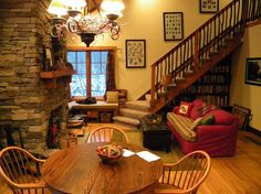 cozy cabin in the woods retreat and fallingwater, home decor, The open dining and living room with stairs up to the loft