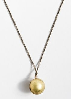 This orb opens up and can act as a mini locket. Don't usually love Brooklyn Industries but the material is all reclaimed too. That's great at $28!