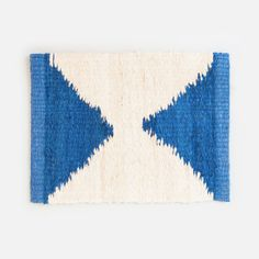 Flat woven rug made from fique, a fiber from a plant (similar to agave sisal) that is commonly grown in South America. It features bold graphic shapes inspired by the American Southwest. It was design
