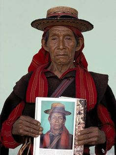 Thirteen years after he was first photographed, a Guatemalan village mayor poses with a photo of himself taken by photographer David Alan Harvey in San Juan Atitán. Photographers in the field often form lasting relationships with their subjects and return to visit friends and revisit the past.